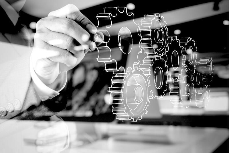 marketing analyst working with projector display of gears