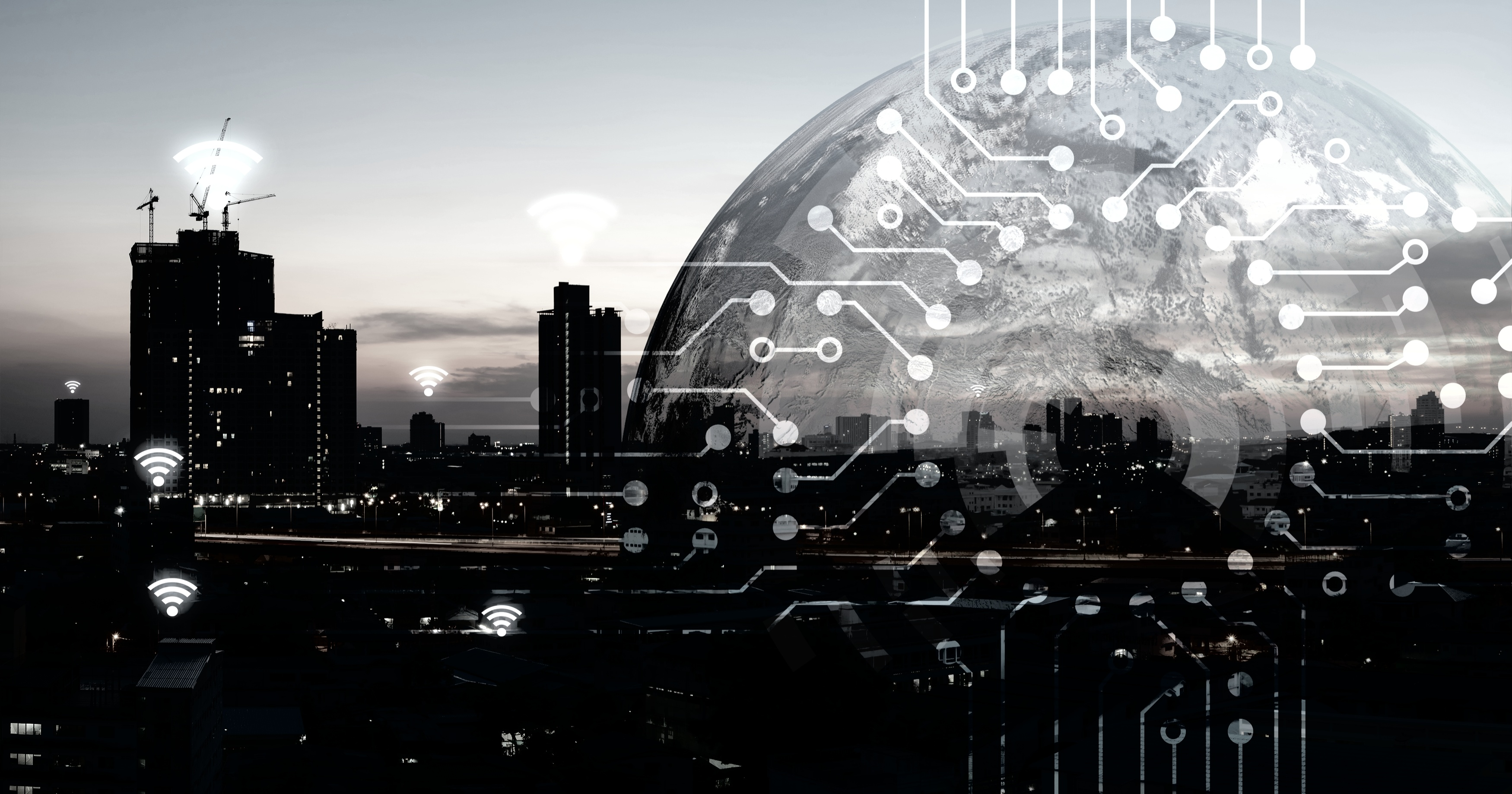 view of city skyline with Internet icons and connected dots on the horizon