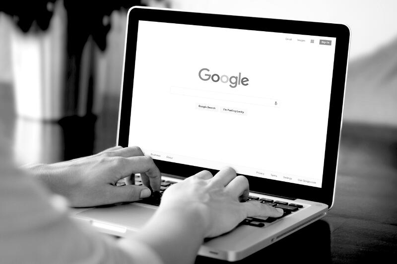 woman using Google search engine on laptop
