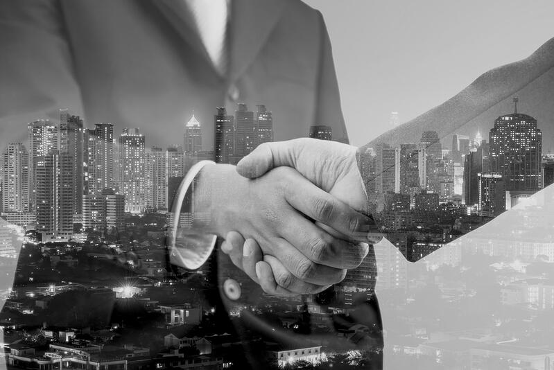 business partnership handshake in the city