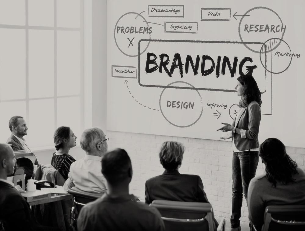 marketing woman giving presentation to marketers about branding