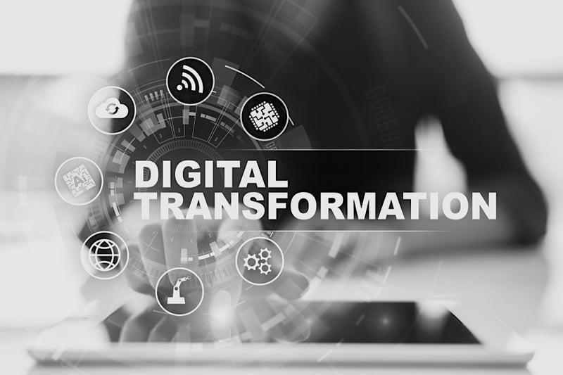 b2b marketing worker taps tablet screen to display digital transformation